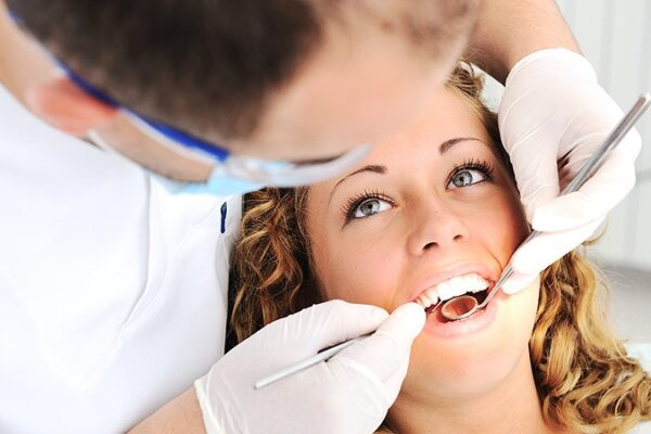 Why is it good to regularly visit a dentist?
